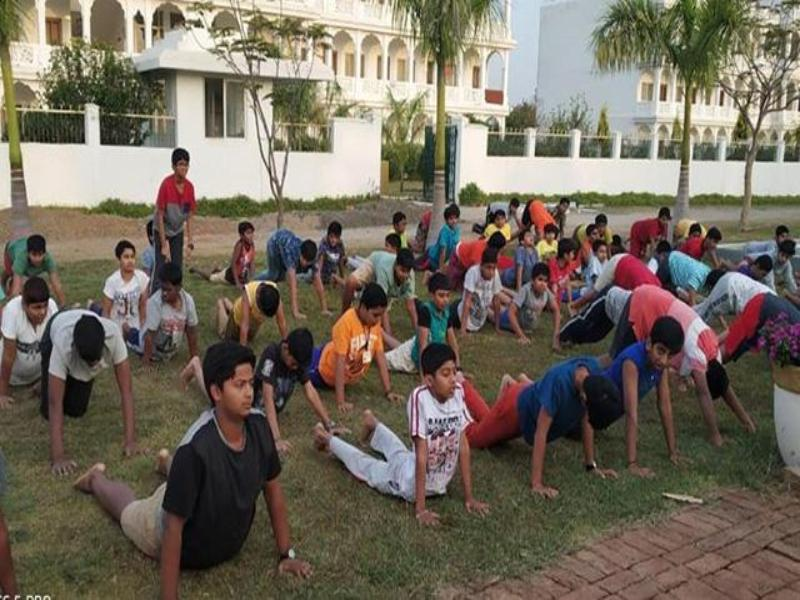 Peace Assembly participants performing Surya Namaskar.
